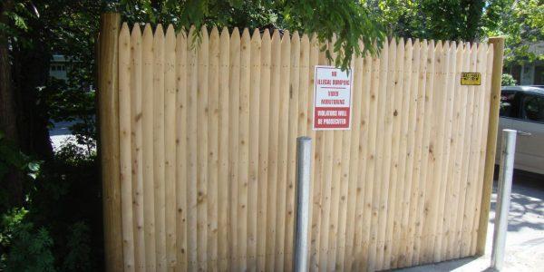#1 grade cedar stockade dumpster enclosure with steel bollards_0